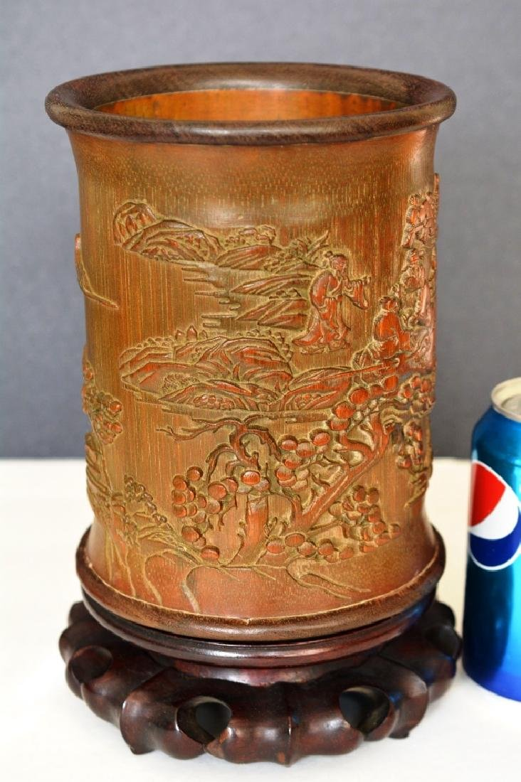 A CARVED BAMBOO BRUSHPOT WITH FIGURE
