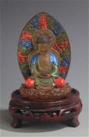 A COLOR AND GILT GLASS AMITAYUS BUDDHA