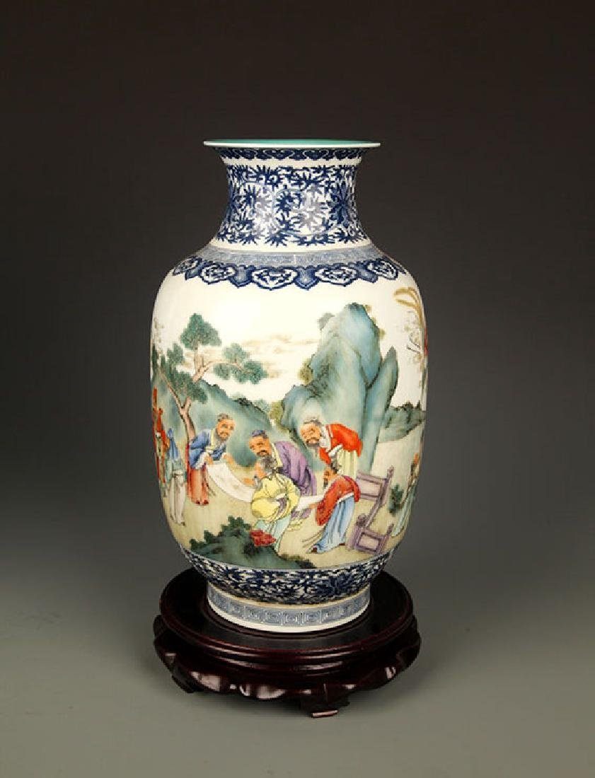 A COLORFUL STORY PAINTED PORCELAIN VASE