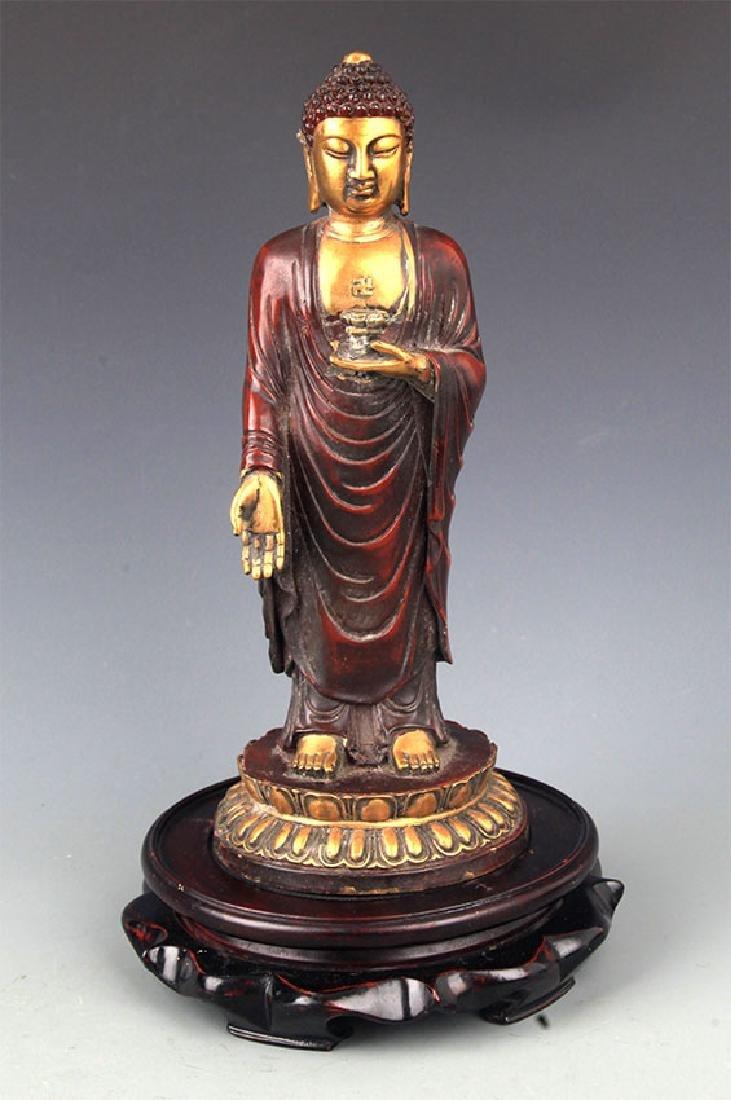 A Tall Gilt Bronze Bhaisayyagaru Buddha