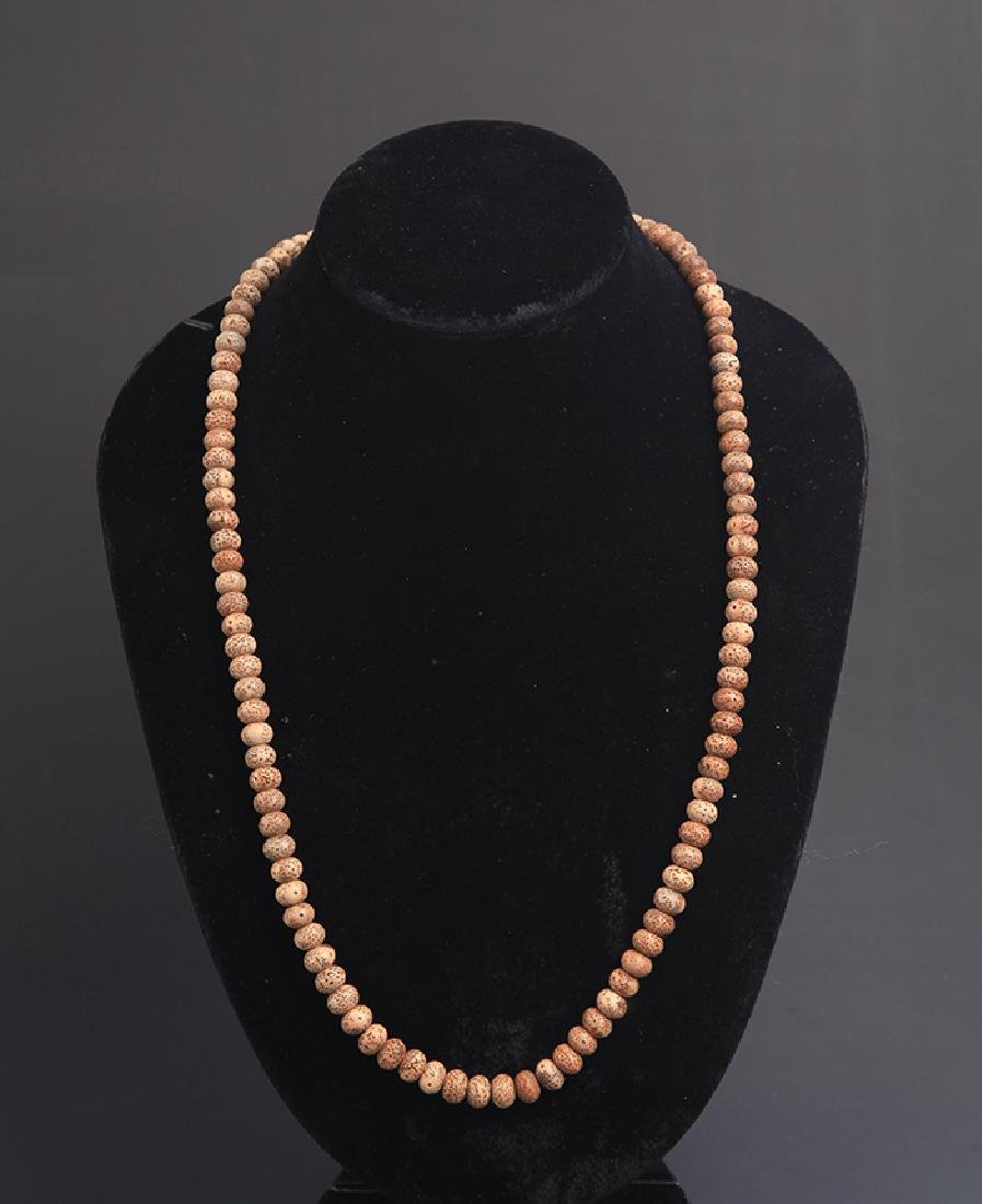 A FINE BUDHI SEED NECKLACE
