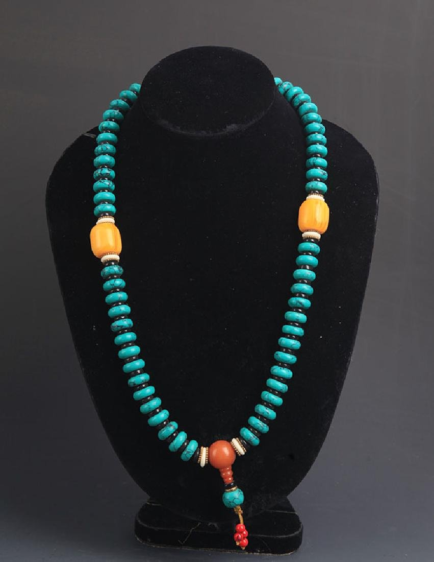 A TURQUOISE WITH BEE WAX NECKLACE