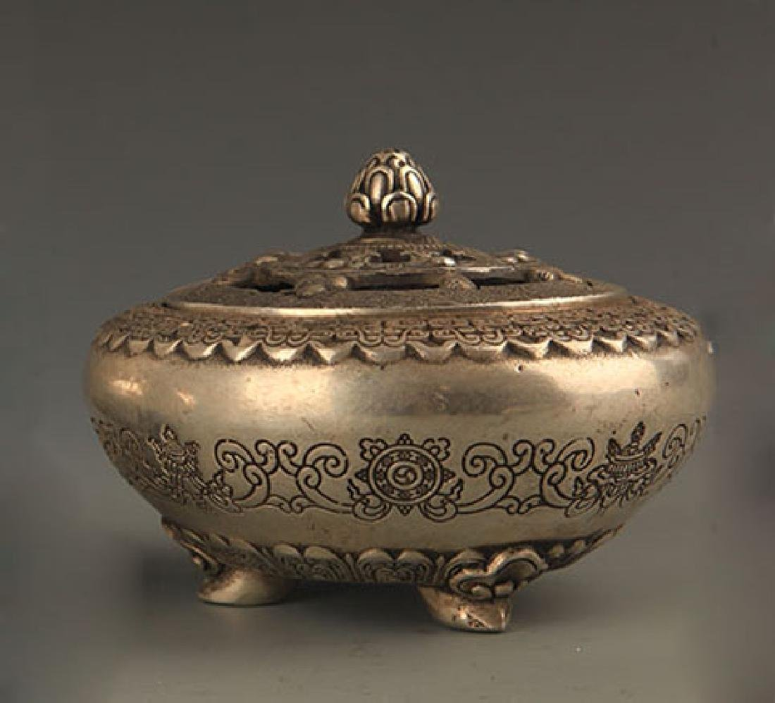 A FINELY CARVED WHITE BRONZE AROMATHERAPY
