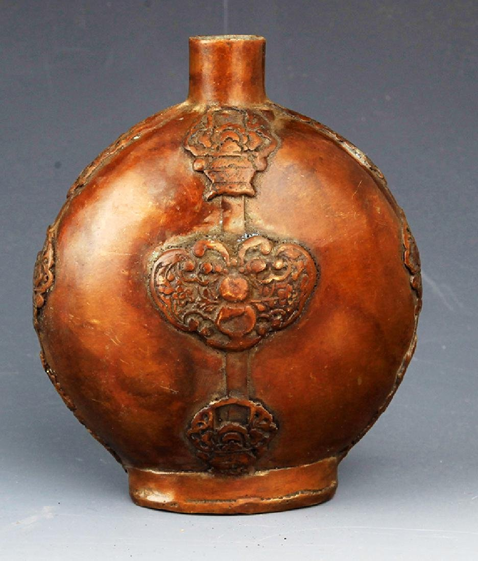 A FINELY CARVED BRONZE WINE EWER