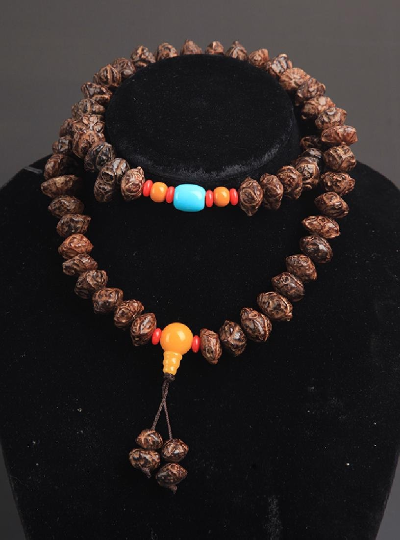 A FINE TREE SEED NECKLACE