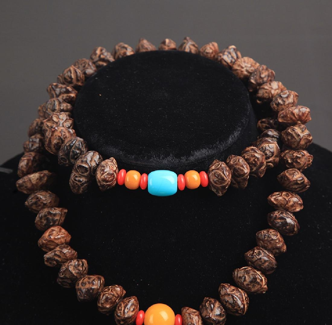 A FINE TREE SEED NECKLACE - 2