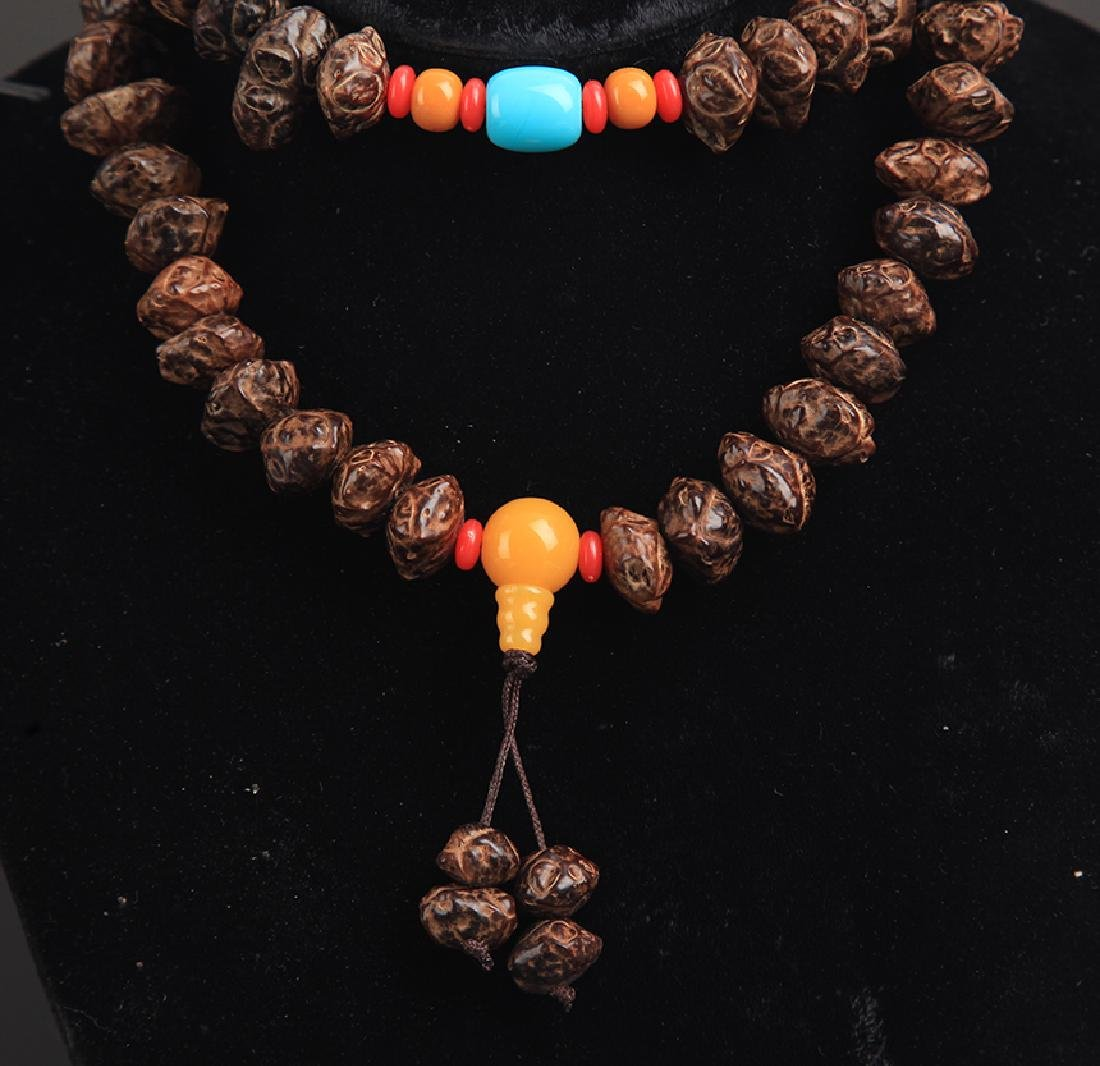A FINE TREE SEED NECKLACE - 3