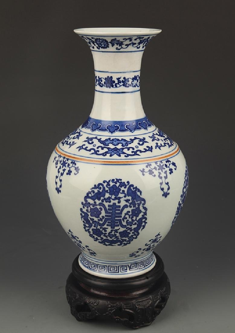 BLUE AND WHITE FIVE BAT PAINTED DECORATIONAL VASE