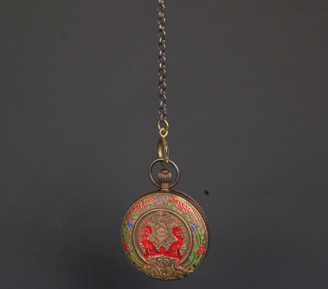 A BRONZE FAIENCE COLOR POCKET WATCH