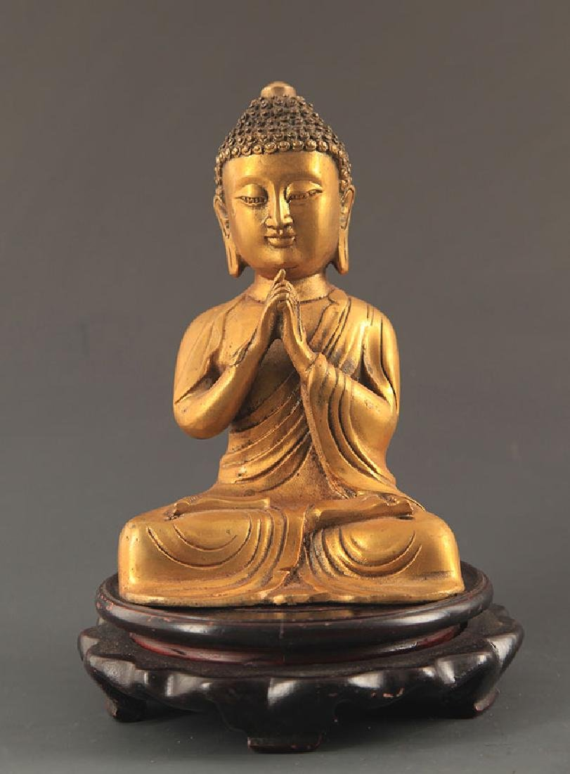 A BRONZE SEATED BUDDHA STATUE