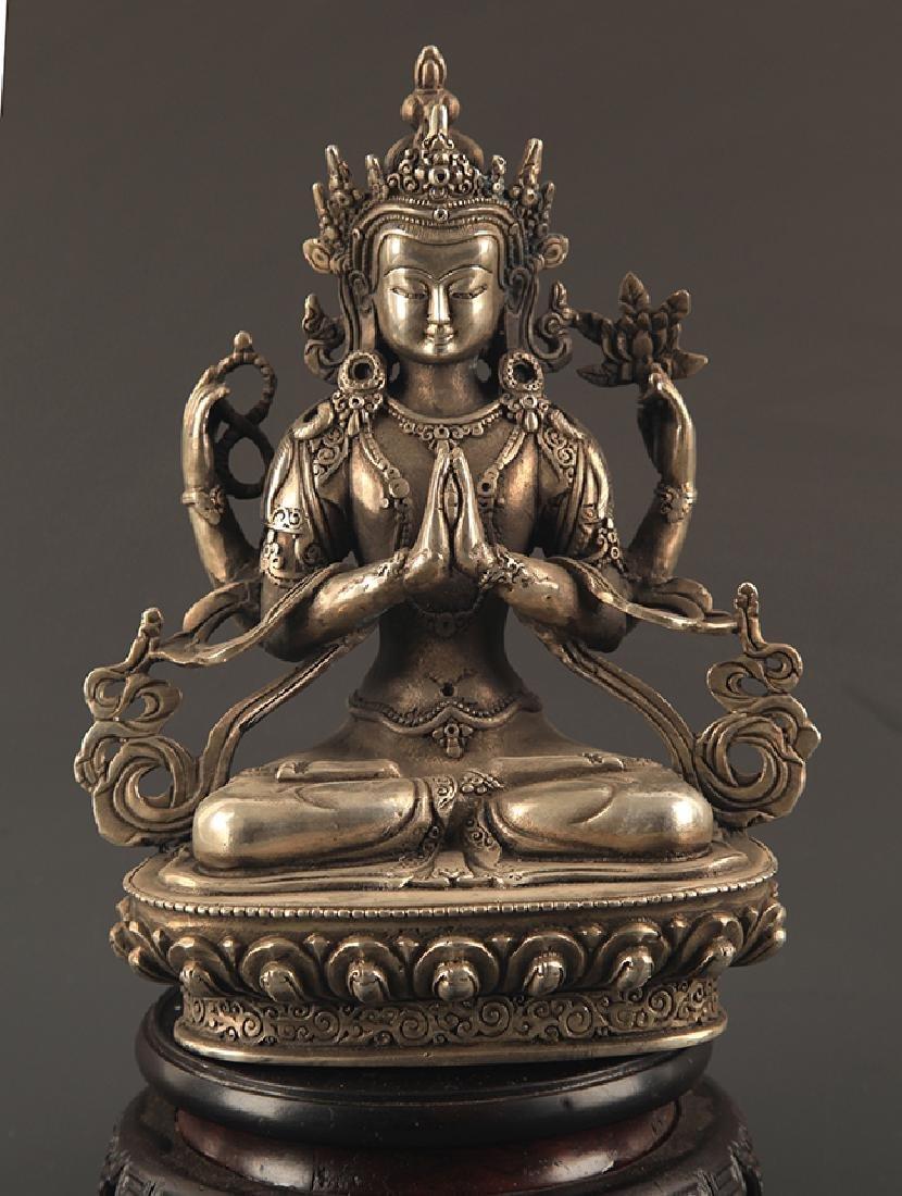 A FINE BRONZE FOUR ARM GUAN YIN BUDDHA