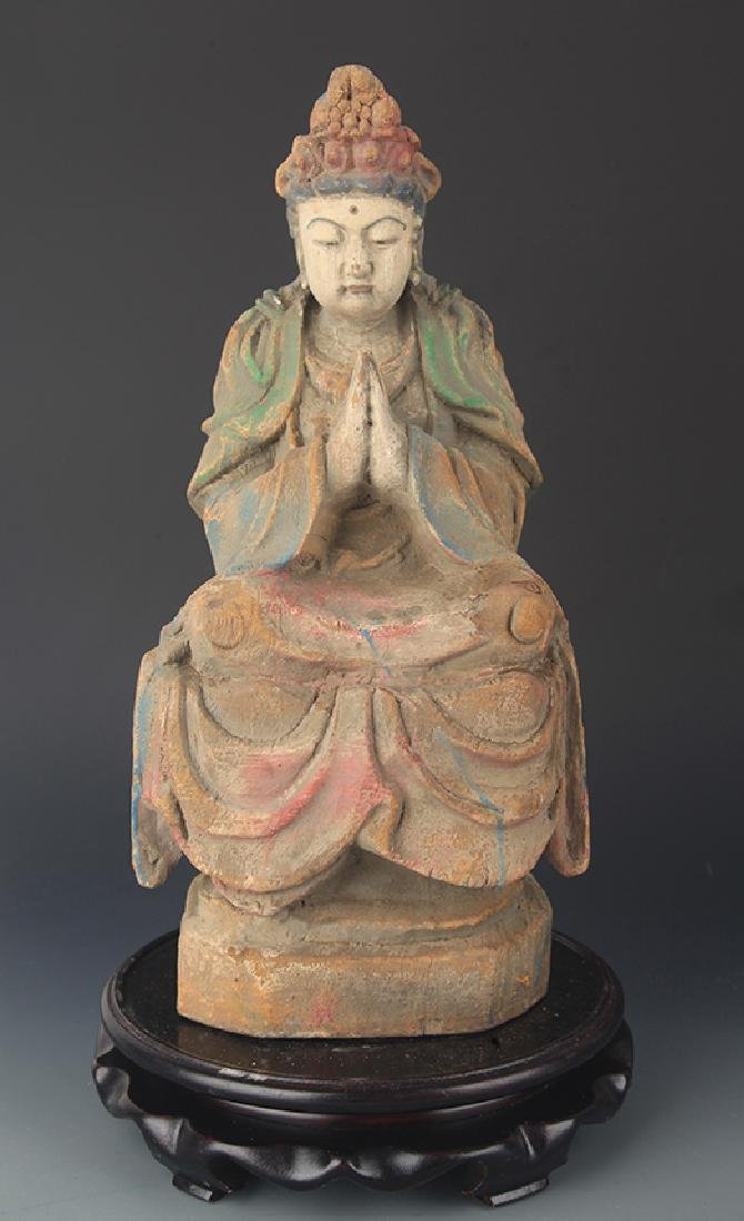 A CARVED AND PAINTED MANJUSRI BUDDHA