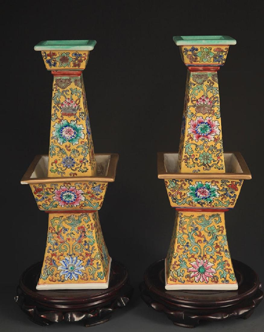 PAIR OF YELLOW GROUND CANDLESTICK