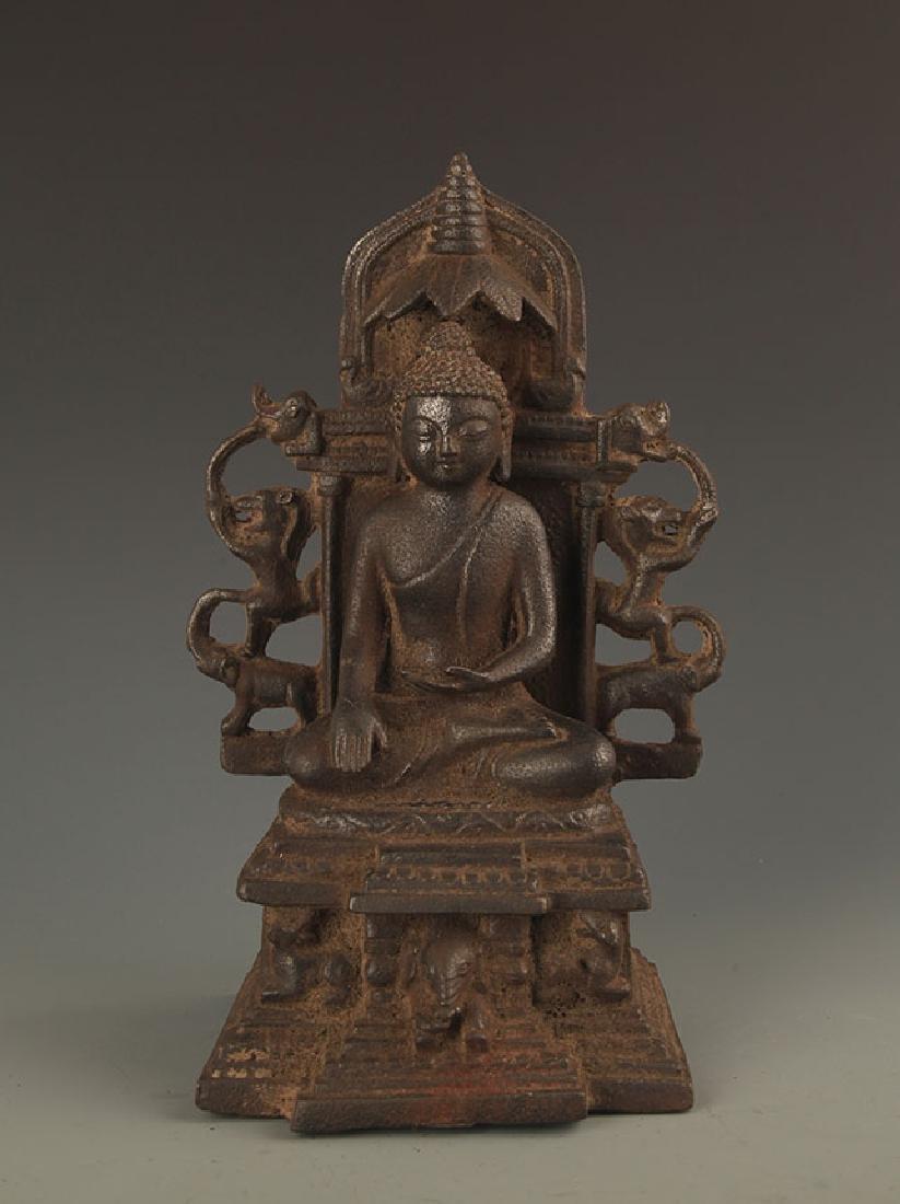 A CAST IRON AKSHOBHYA BUDDHA STATUE