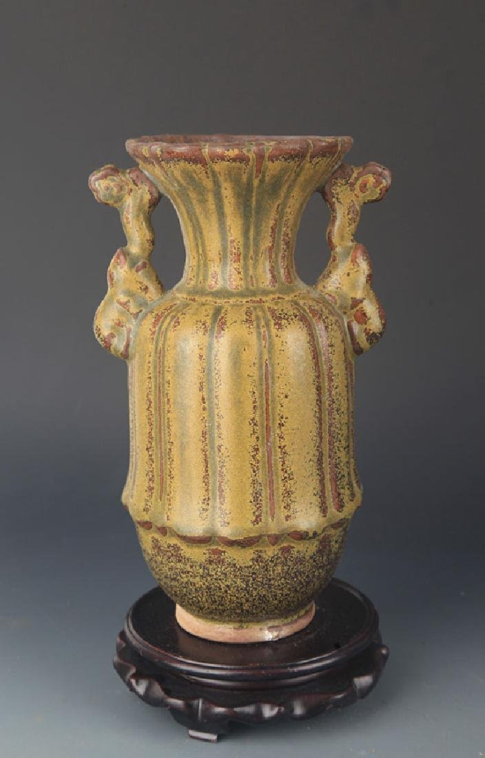 A TEA COLOR GLAZED PORCELAIN VASE