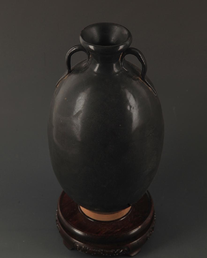 A BLACK GLAZED TWO TILE JAR - 2