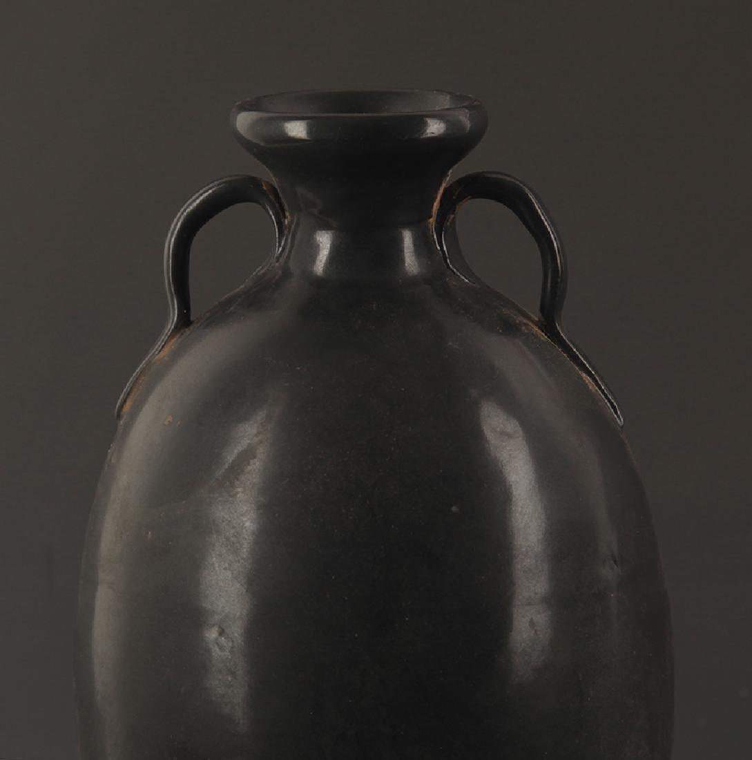 A BLACK GLAZED TWO TILE JAR - 3