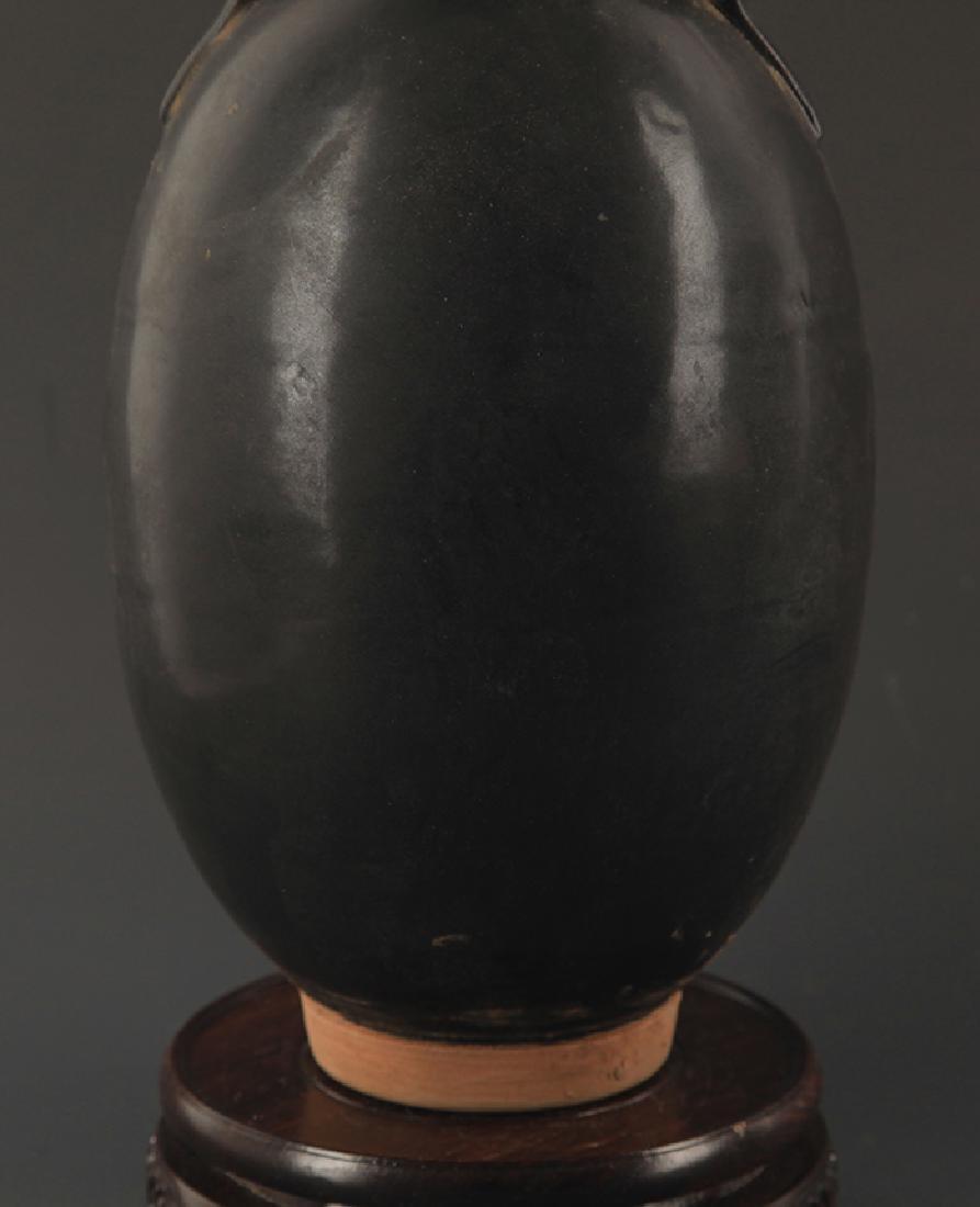 A BLACK GLAZED TWO TILE JAR - 4