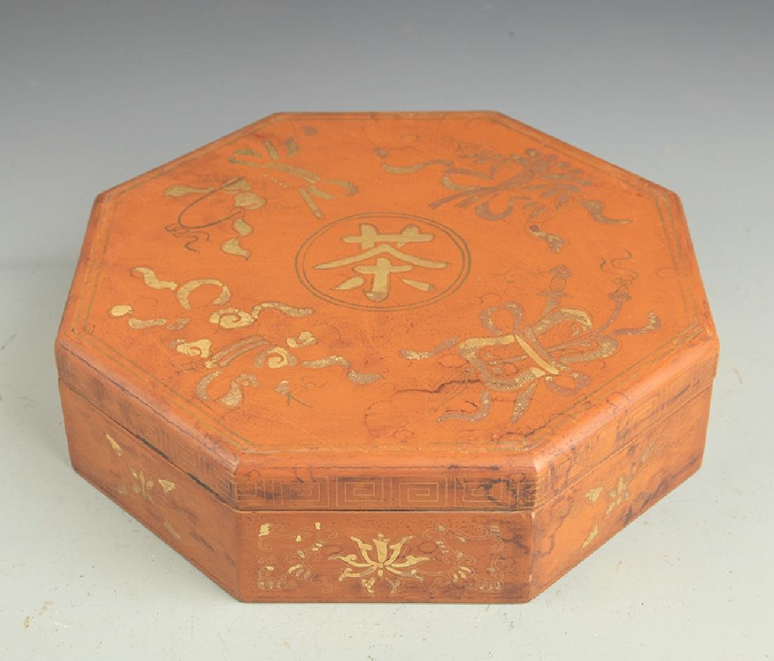 A GILT LACQUER EIGHT SIDE WOODEN BOX WITH COVER