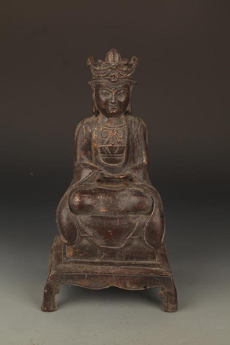 A FINELY CARVED BRONZE GUAN YIN BUDDHA