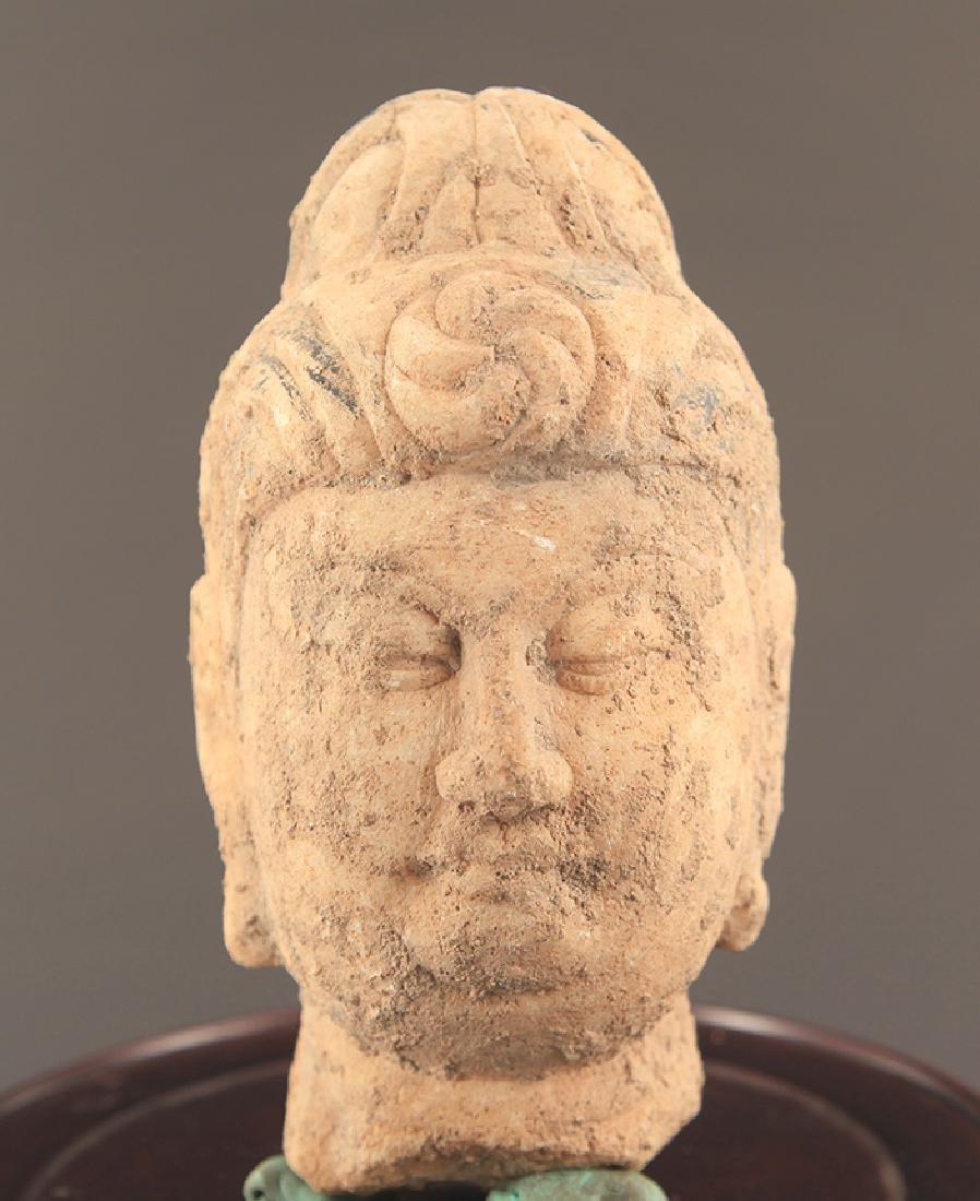 A LARGE STONE BUDDHA HEAD