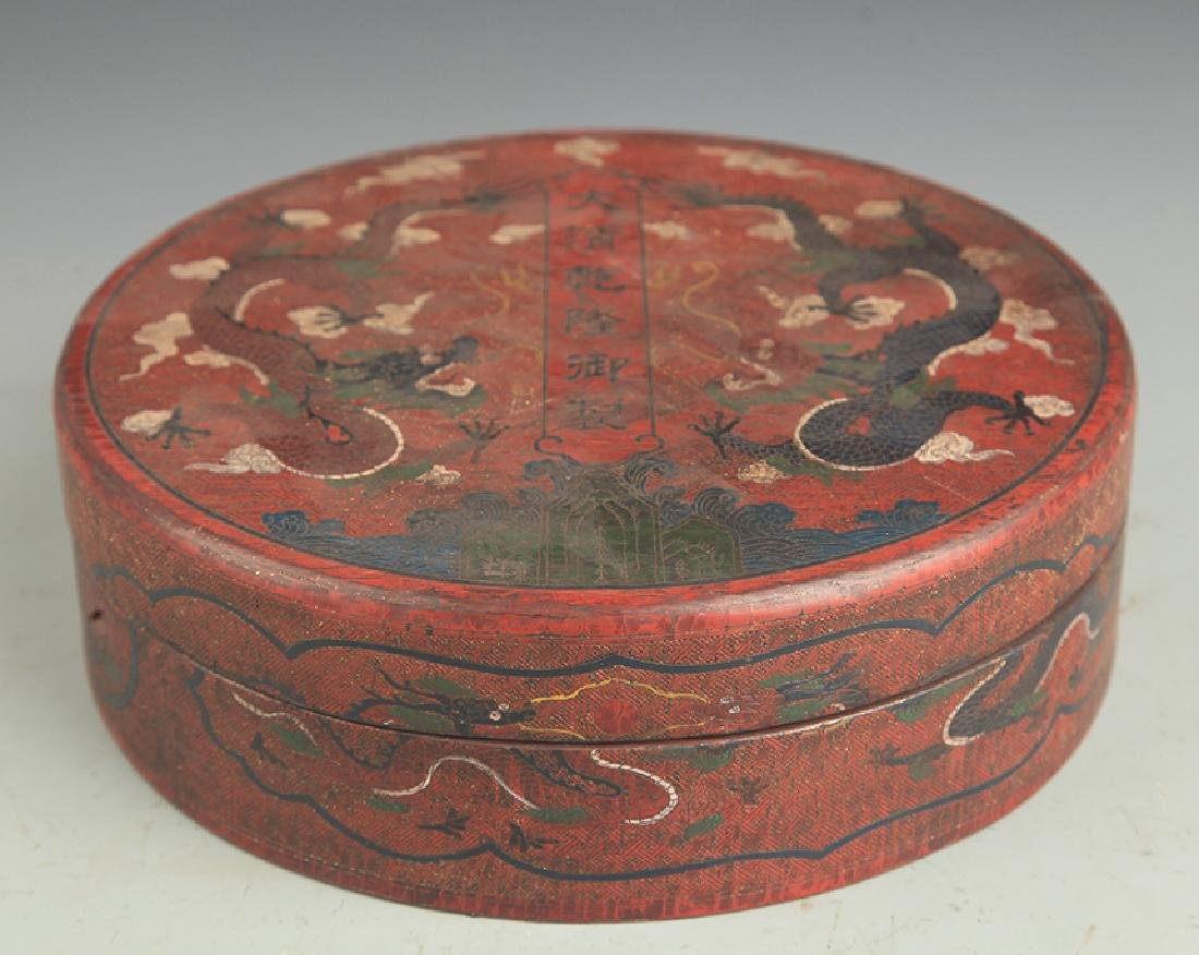 A GILT LACQUER DRAGON PAINTED WOODEN BOX
