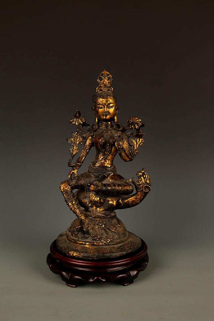 A TALL TIBETAN BRONZE FEMALE BUDDHA FIGURE