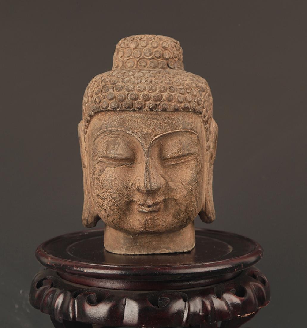 A FINELY CARVED STONE BUDDHA HEAD