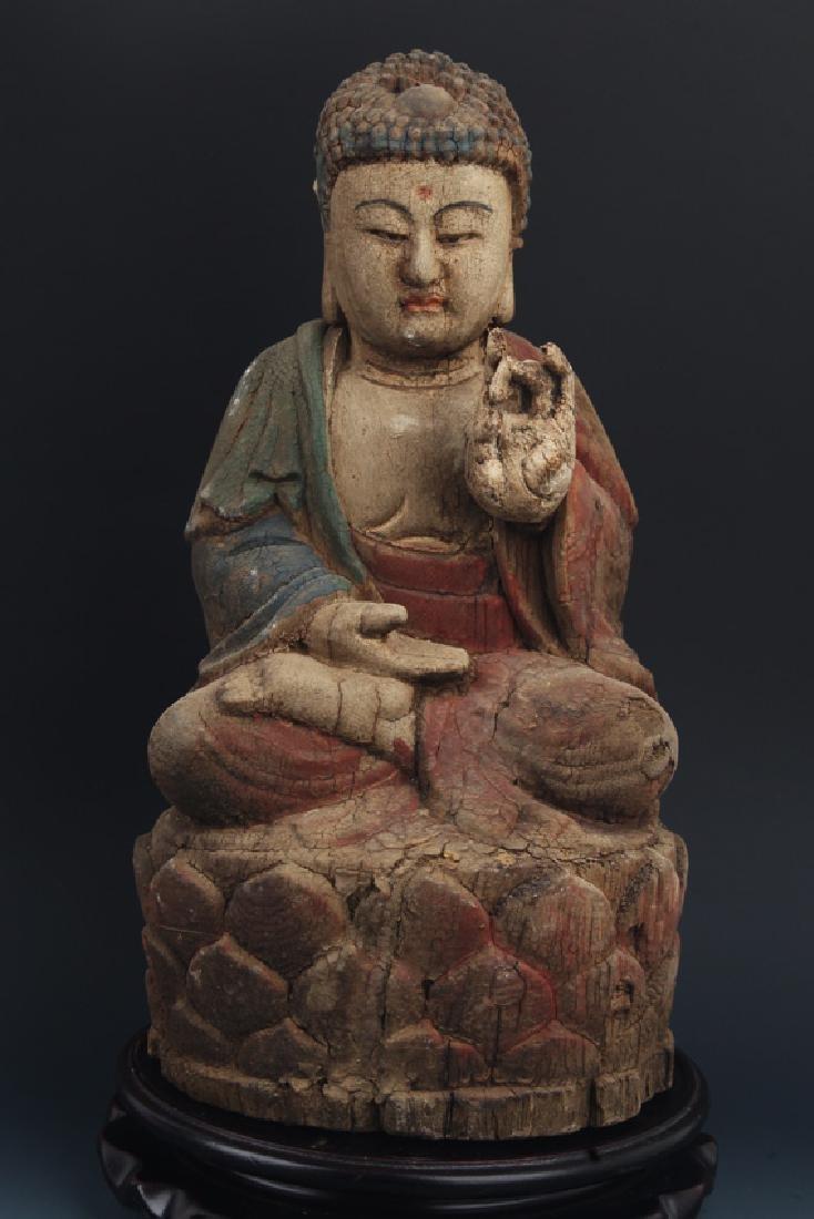A WOOD COLORED AKSHOBHYA BUDDHA