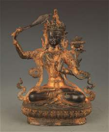 A BRONZE TIBETAN MANJUSRI BUDDHA