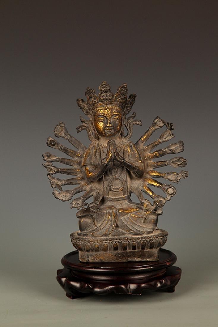 A FINELY CARVED THOUSAND HAND BUDDHA FIGURE