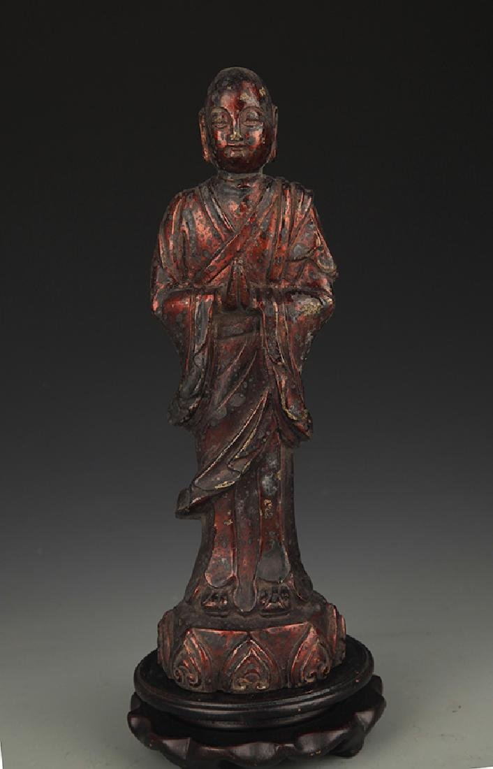A FINELY CARVED BRONZE IN ROHAN FIGURE