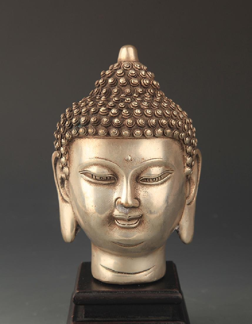 A FINELY CARVED BRONZE AKSHOBHYA BUDDHA HEAD