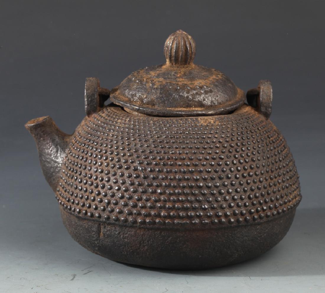 AN OLD IRON TEAPOT AND TIBETAN BUDDHISM DECORATION - 2