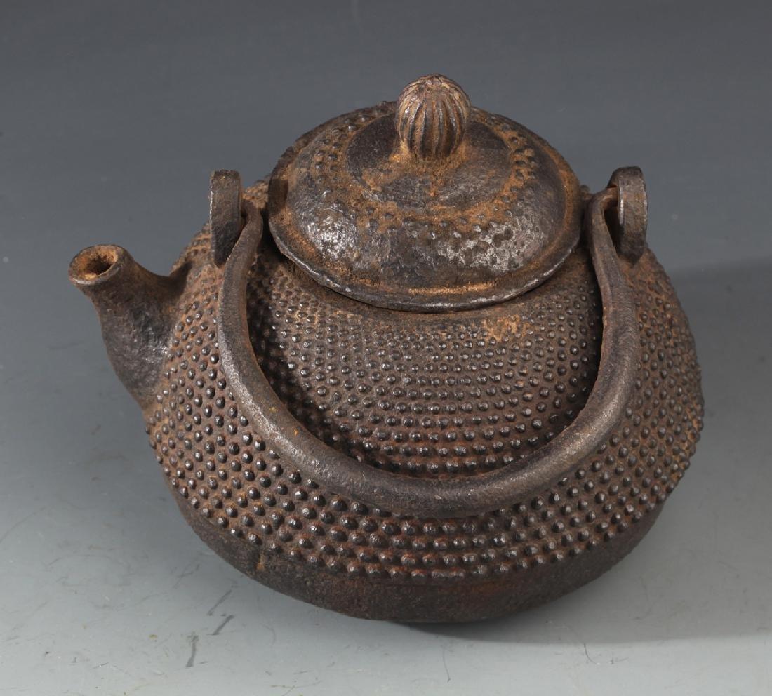 AN OLD IRON TEAPOT AND TIBETAN BUDDHISM DECORATION - 3