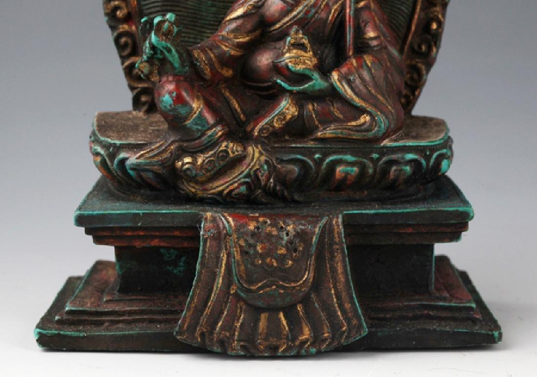 AN OLD IRON TEAPOT AND TIBETAN BUDDHISM DECORATION - 9
