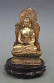 A FINE GILT BRONZE AKSHOBHYA BUDDHA WITH BASE