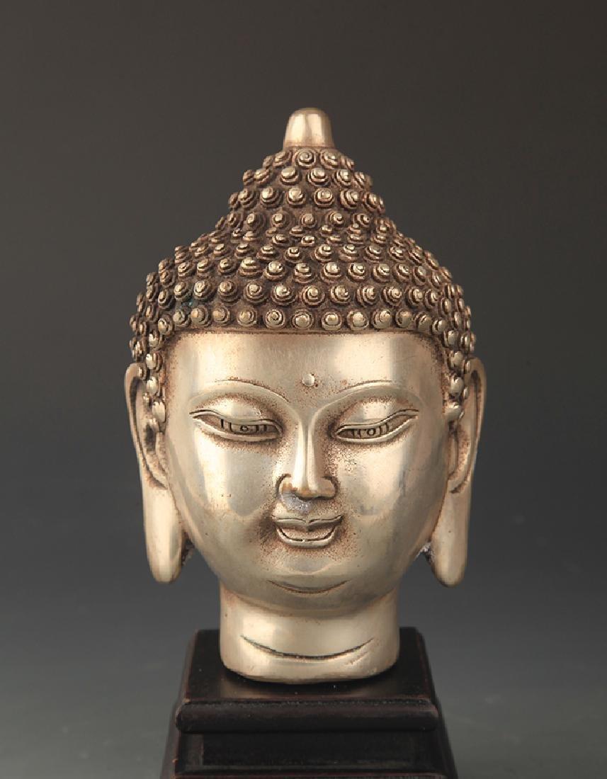 A FINELY CARVED BRONZE AKSHOBHYA BUDDHA HEAD