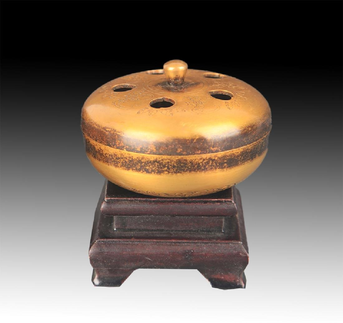 A FINELY CARVED ROUND BRONZE AROMATHERAPY