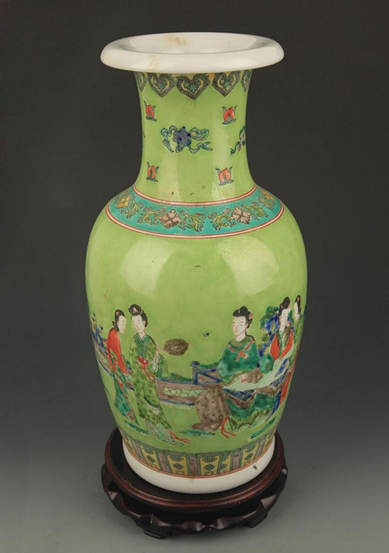 GREEN GROUND FAMILLE ROSE STORY PAINTED PORCELAIN VASE