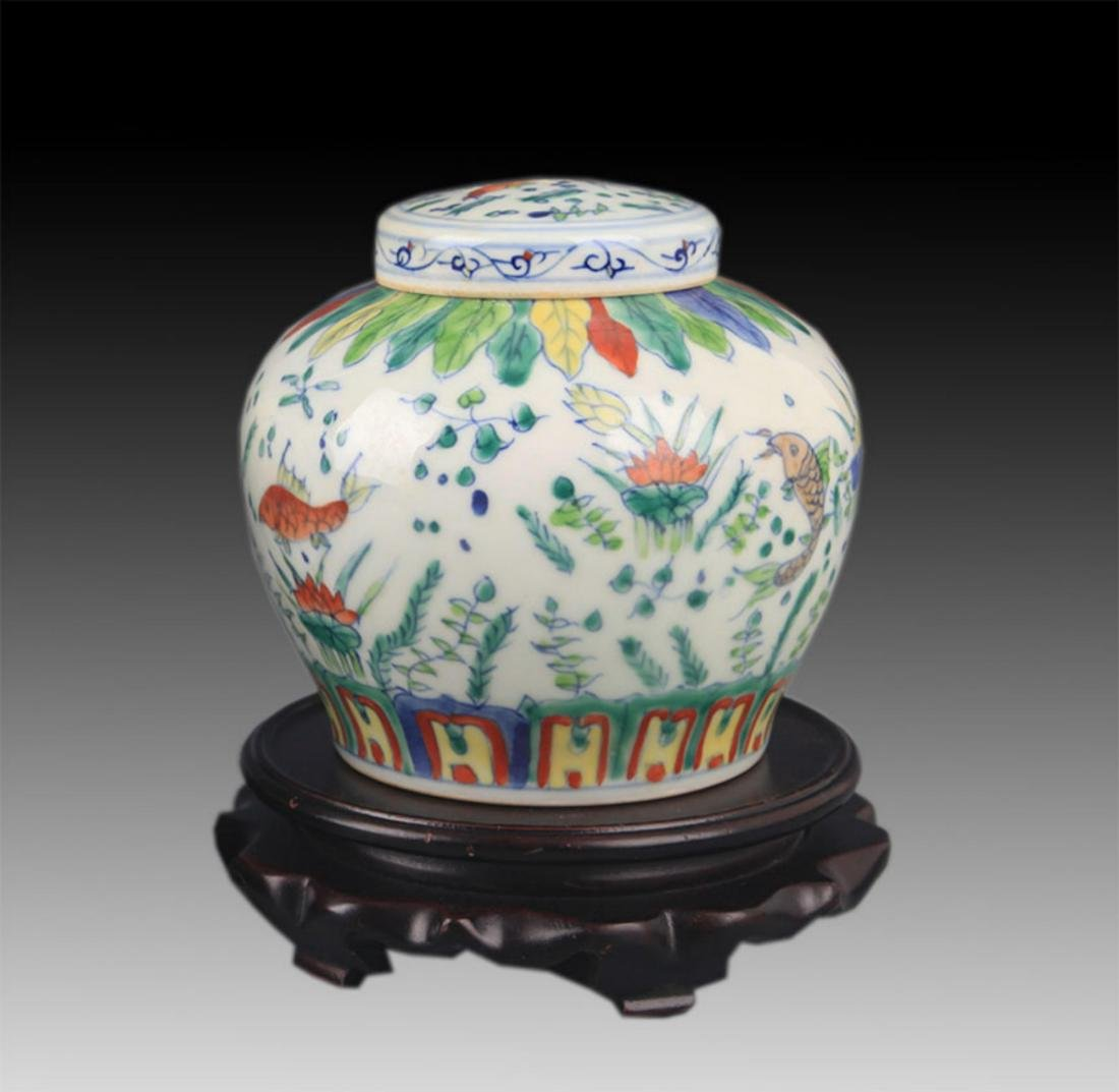 A DOUCAI COLOR PORCELAIN VASE WITH COVER