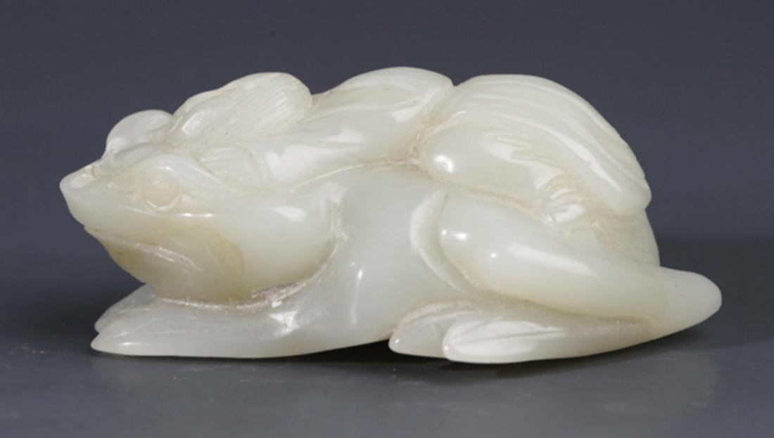 A FINELY THREE FOOT TOAD SHAPED GREENISH WHITE JADE