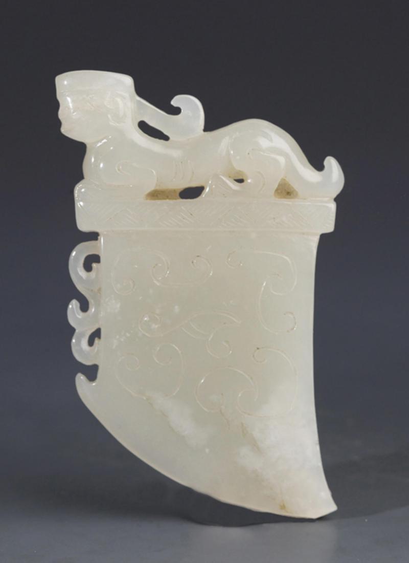 A FINELY AXE SHAPE GREENISH WHITE JADE PENDANT