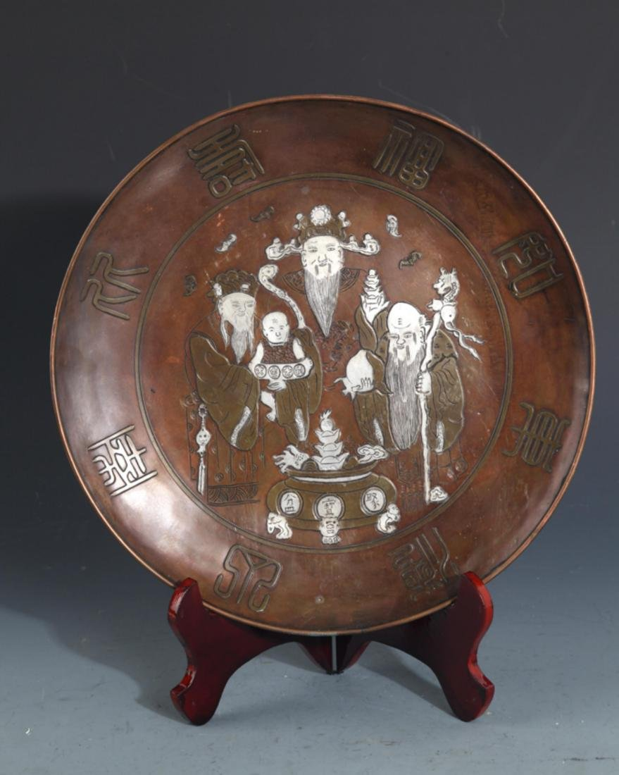 A FINELY CARVED SILVER-INLAID BRONZE PLATE