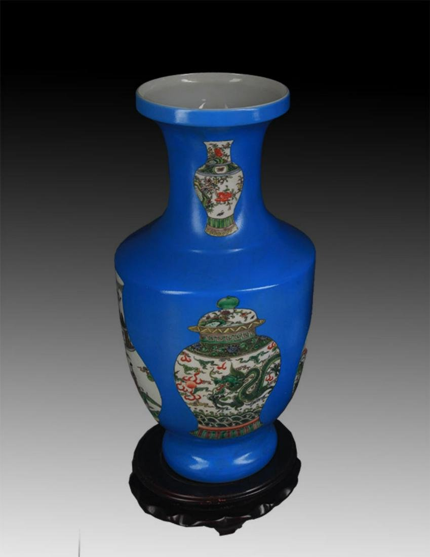 A BLUE GROUND FAMILLE ROSE PORCELAIN VASE