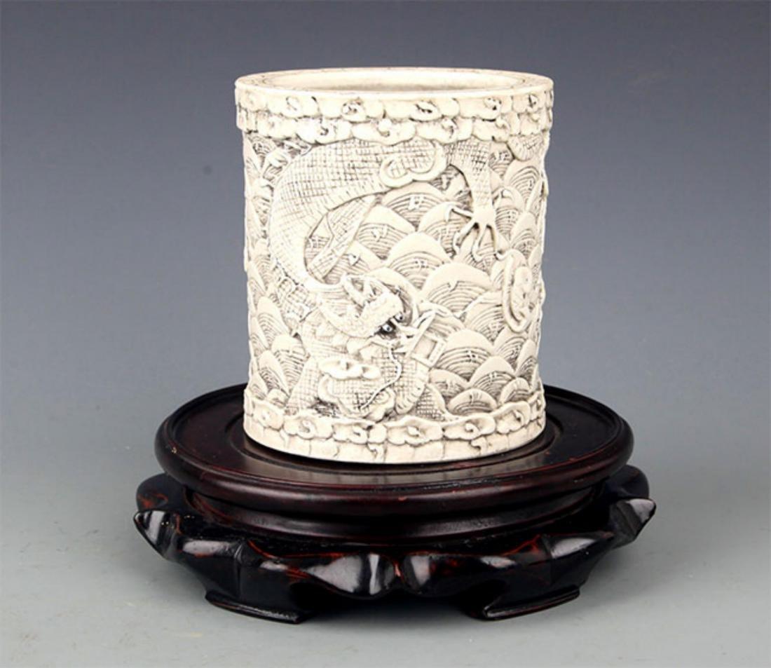 A WHITE COLOR GLAZED PORCELAIN BRUSH HOLDER