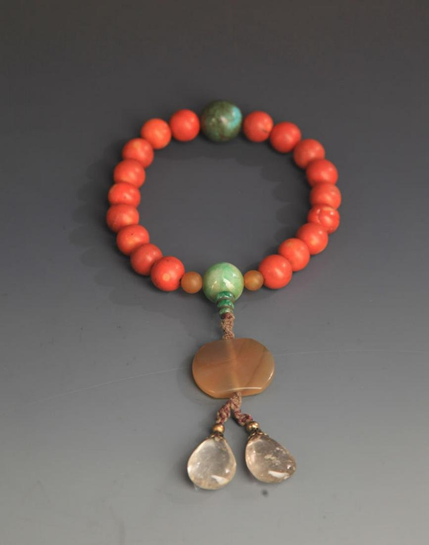 A FINE CORAL COURT ROYAL BRACELETS