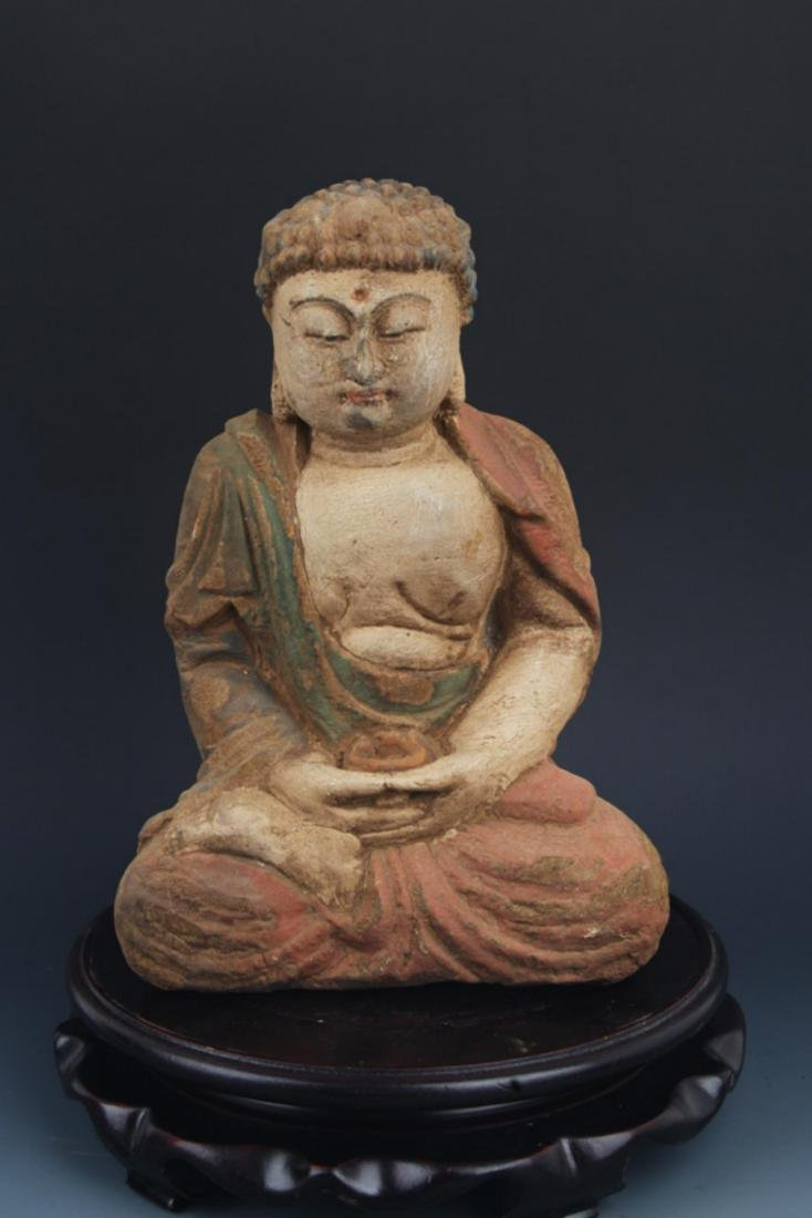 A FINELY COLORED WOODEN PHARMACIST BUDDHA