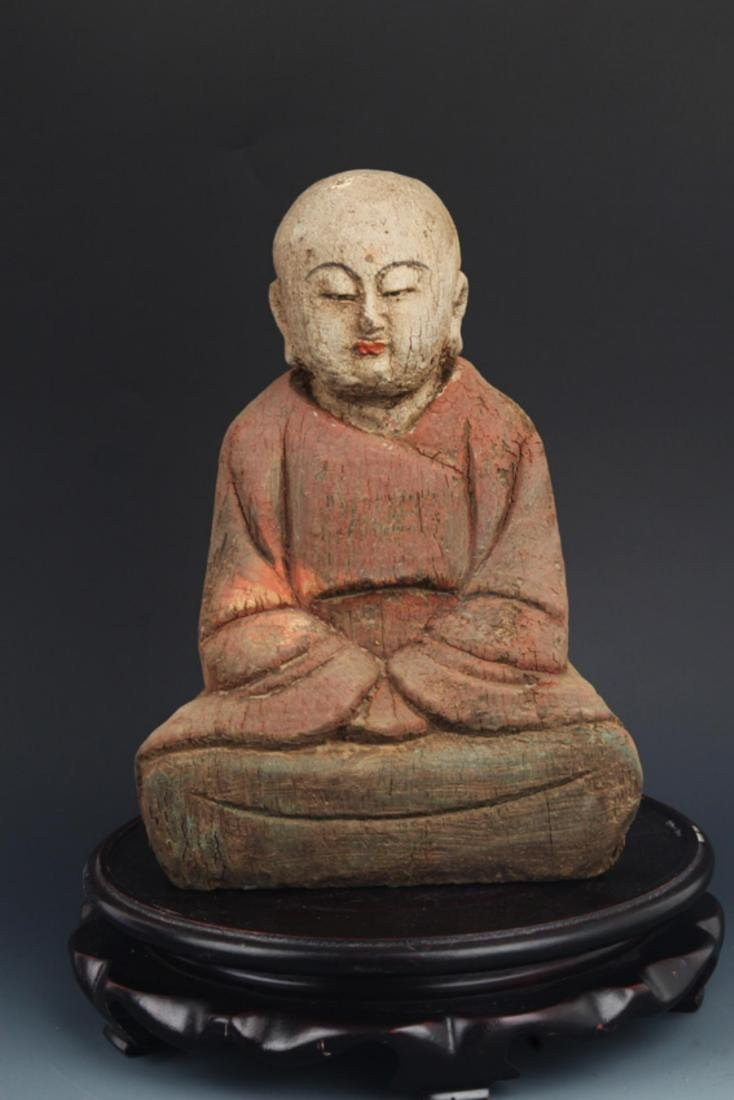 A FINE WOODEN COLORED SMALL BUDDHA STATUE
