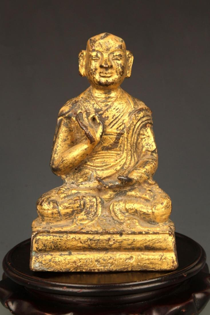 A FINE GILT BRONZE STATUE IN FIGURE OF GANDHARA